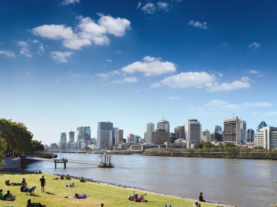 View of people picnicing at South Bank, Brisbane, with Brisbane CBD in the background