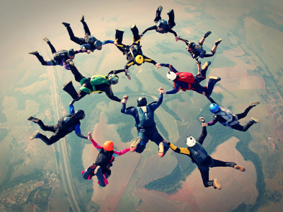 Skydivers holding hands in formation