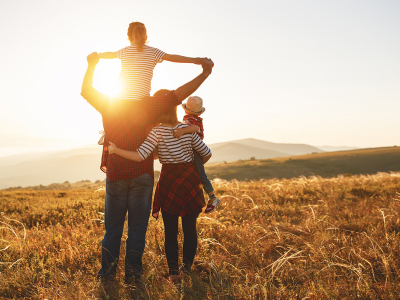 Image of a family at sunset