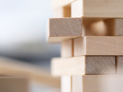 Image of stacked wooden blocks with one pulled out